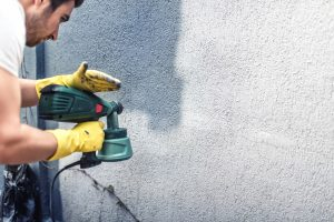 melbourne paint painting a grey wall renovating exterior walls of new house| Melbourne Paint