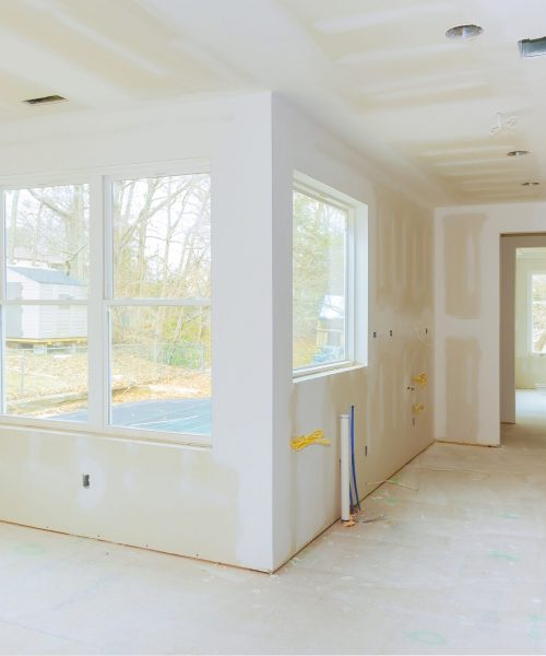 melbourne paint Interior construction of housing project with drywall installed and patched without painting applied